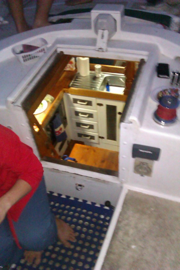 Cooking in tiny kitchens, like this one. Mind your head.